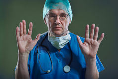 Doctor with Mask. & Stethoscope arms folded Royalty Free Stock Images