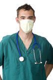 Doctor with a mask. A young doctor or nurse stands with a mask on his face Stock Image