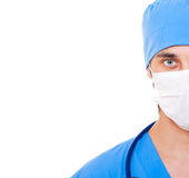 Doctor in mask and blue uniform. Portrait of doctor in mask and blue uniform. isolated on white background Stock Photography