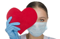 Doctor in a mask covering her eyes heart symbol Stock Photo
