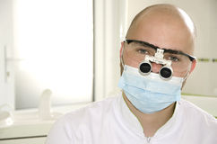 Doctor in a mask and glasses Stock Photos
