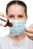 Doctor in mask holding medicine syrup Royalty Free Stock Photography