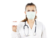 Doctor in a mask holds a card Royalty Free Stock Images