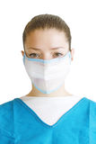 Doctor in a Mask. A portrait of a female doctor or nurse in a mask isolated on white Royalty Free Stock Image