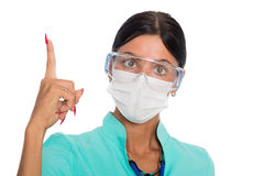Doctor in a mask with a raised finger Stock Image