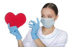 Doctor in mask tunic heart Stock Photography