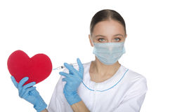 Doctor in mask tunic red heart symbol Stock Photos