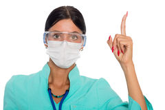 Doctor in a mask with a warning gesture Stock Images