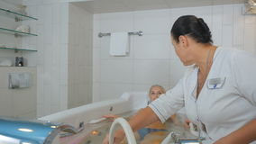 The doctor massages the pretty woman in hydrobath stock footage