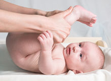 Doctor massaging baby Stock Images