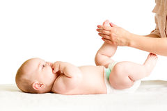 Doctor massaging or do gymnastics baby girl Royalty Free Stock Image