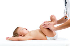 Doctor massaging or doing gymnastics baby girl. Doctor massaging or doing gymnastics little girl Royalty Free Stock Photo