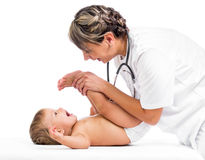 Doctor massaging or doing gymnastics smiling baby Stock Photography