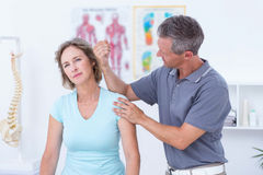 Doctor massaging his patient shoulders Royalty Free Stock Photography