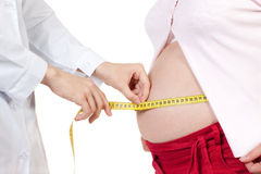 Doctor measures belly of the pregnant woman Royalty Free Stock Photography