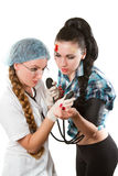 Doctor measures the blood pressure a girl Stock Photos