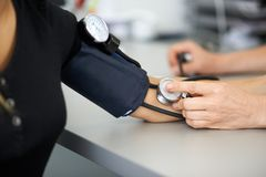 Doctor measures the blood pressure of a patient. In the hospital Royalty Free Stock Images