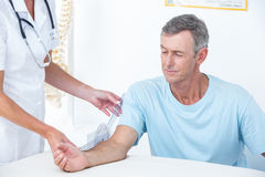 Doctor measuring arm with goniometer Royalty Free Stock Images