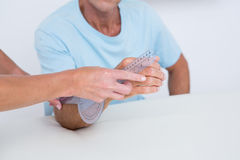 Doctor measuring arm with goniometer Stock Photography