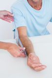 Doctor measuring arm with goniometer Stock Photo