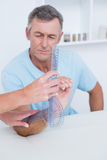 Doctor measuring arm with goniometer Royalty Free Stock Photo