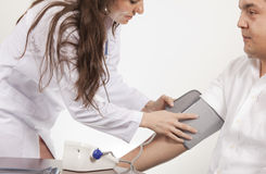 Doctor is Measuring blood pressure Stock Image