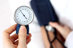 Doctor measuring the blood pressure Stock Image
