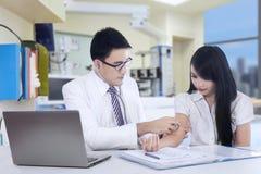 Doctor measuring blood pressure Stock Images