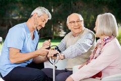Free Doctor Measuring Blood Pressure Of Senior Man Royalty Free Stock Images - 46381959