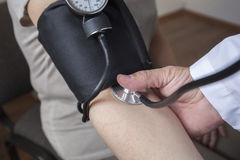 Doctor is Measuring a Blood Pressure of a Patient Stock Image
