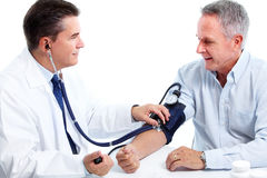 Doctor measuring blood pressure. stock photos