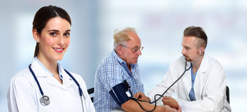 Doctor measuring blood pressure. stock images