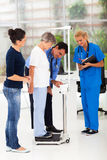 Doctor measuring height weight Stock Photos