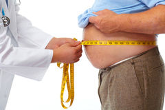 Doctor measuring obese man stomach. royalty free stock photos
