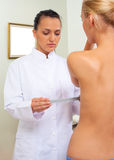 Doctor measuring patient breast Royalty Free Stock Photo
