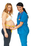 Doctor measuring pregnant belly Stock Photo