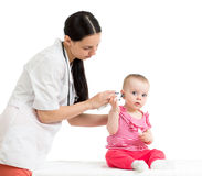 Doctor measuring temperature baby girl Stock Image
