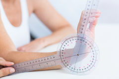 Doctor measuring wrist with goniometer Royalty Free Stock Photo