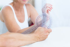 Doctor measuring wrist with goniometer Royalty Free Stock Photos