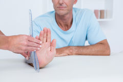 Doctor measuring wrist with goniometer Royalty Free Stock Photography