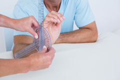 Doctor measuring wrist with goniometer Royalty Free Stock Image