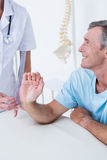 Doctor measuring wrist with goniometer Royalty Free Stock Images
