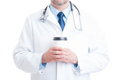 Doctor or medic holding coffee to go cup Royalty Free Stock Images