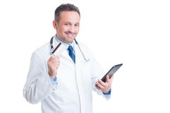 Doctor or medic holding credit  card and wireless tablet Stock Images