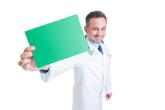 Doctor or medic holding green blank paper with copy space Stock Images
