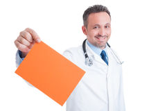Doctor or medic holding orange blank paper with copy space Stock Image