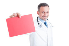 Doctor or medic holding red blank paper with copy space Royalty Free Stock Images