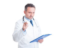 Doctor or medic looking and pointing finger at camera Stock Image