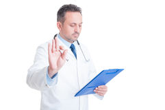 Doctor or medic making hold and wait gesture Stock Photos