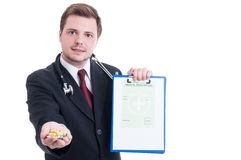 Doctor or medic offering medicine on medical prescription Royalty Free Stock Photography